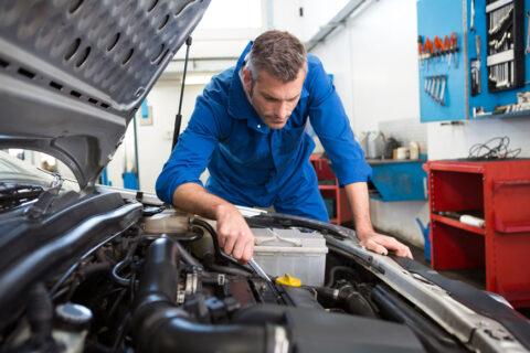Mechanic in Engine Bay