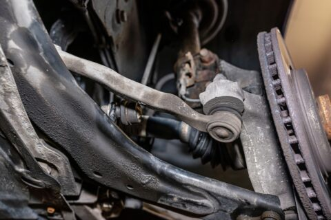 steering-stabilizer-connected-with-steering-knuckle-seen-from-the-bottom-of-the-car-on-a-jack-in-the_t20_Xv0vgG