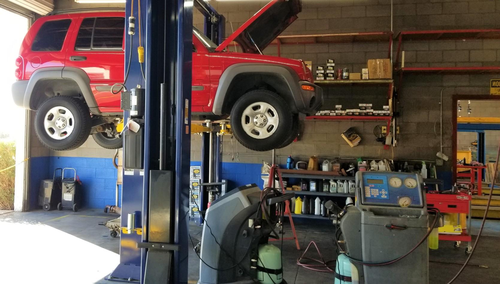 automotive-repair-garage-mechanic-work-on-vehicles-in-an-automotive-repair-shop-vehicles-up-on-lifts_t20_gRbBKG